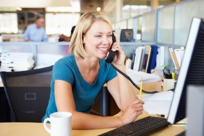 Blonde Woman Calling Business on Telephone